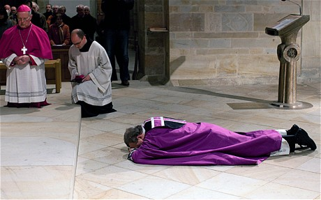 The Bishop of Osnabruck Franz-Josef Bode falls to the floor at the Dome of Osnabrueck. Bode is the first German Bishop to apologize for the sexual abuse scandals Photo: EPA